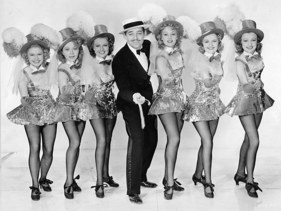Party like it's 1939... and you're Clark Gable in Idiot's Delight, surrounded by dancers with strangely proportioned heads! (Image: Fanpop)