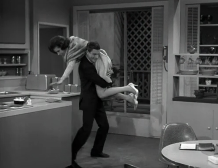 Rob has to quite literally carry Laura out of the house to make her go to the party. (Screen capture by Lindsey for TMP)