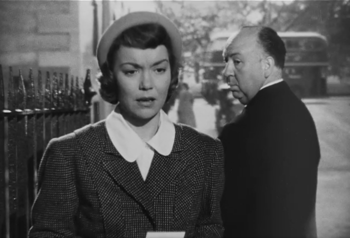 """New favorite Hitchcock cameo: Hitch gives """"Eve"""" the stink eye when he passes her on the street as she practices what she'll say to Charlotte. (Screen capture by Lindsey for TMP)"""