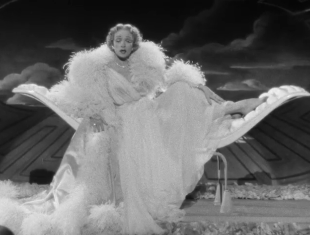 """Dietrich sings """"The Laziest Girl in Town"""" (Screen capture by Lindsey for TMP)"""