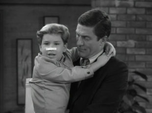 Ritchie pretends he's been punched in the nose after hearing that his dad punched Jerry in the nose. (Screen capture by Lindsey for TMP)