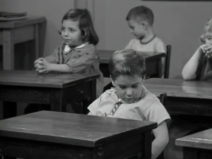 Richie mopes at his desk when his father visits the class to talk about his work. (Screen capture by Lindsey for TMP)