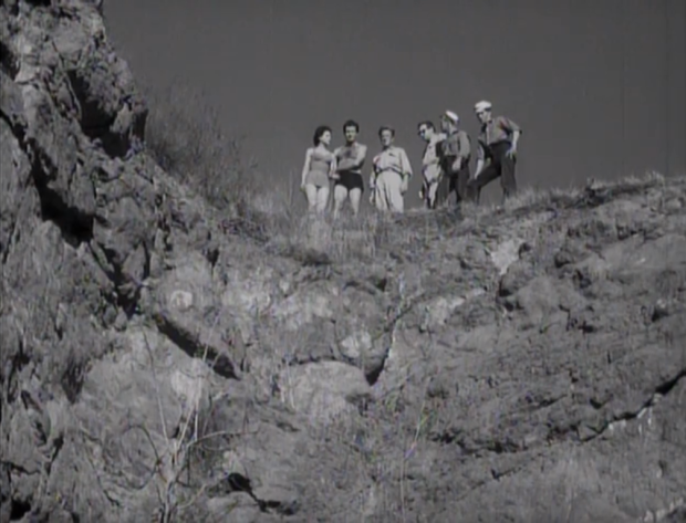 Scientists stand on an island cliff in Attack of the Crab Monsters(Screen capture by Lindsey for TMP)