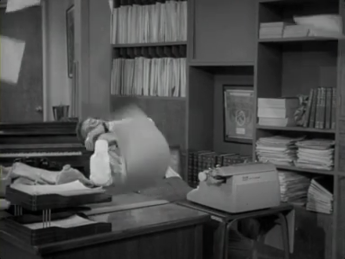 "Rob makes a mess of his office while ""drunk."" (Screen capture by Lindsey for TMP)"