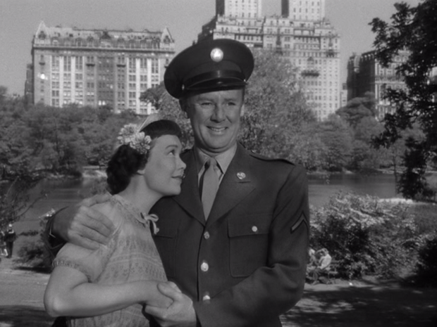 Ruth and Art's relationship grows as they continue to spend time together. Here, they pose for a photo while on a date in the park. (Screen capture by Lindsey for TMP)