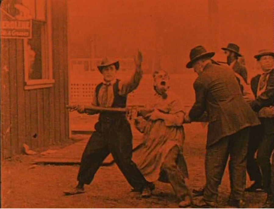 Keaton's got to put out a fire! (Screen capture by Lindsey for TMP)
