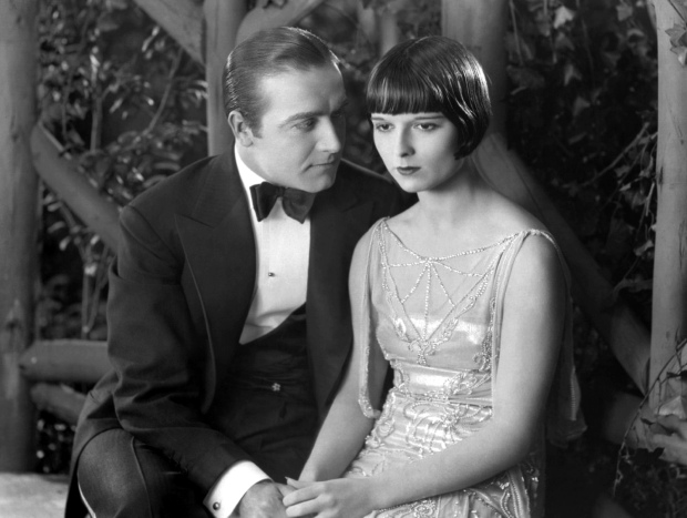 Louise Brooks with Hugh Huntley for A Social Celebrity, a film which Cora watches in a Witchita theater years after her journey with Louise. (Image via Doctor Macro)