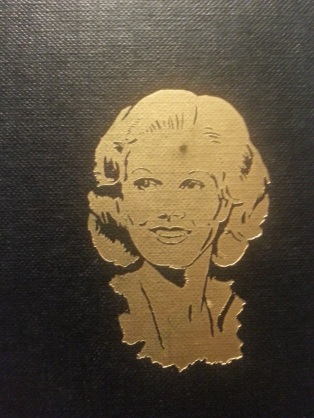 This golden illustration of Jean appears on the bottom right of the book's front cover. (Photo by Lindsey for TMP)