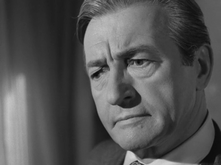 Claude Rains as Howard Justin, Mary's husband (Screen capture by Lindsey for TMP)