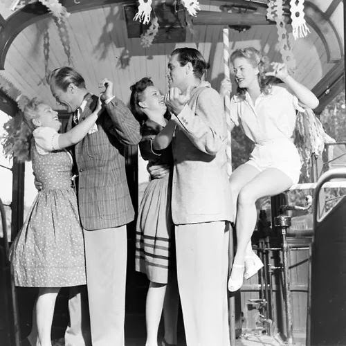 Ain't no party like a '42 party, cause a '42 party... is held in a streetcar! (Image via vintag.es)