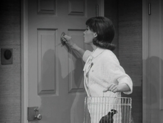 Laura is afraid to even answer the door, being home alone in the scary town of New Rochelle. (Screen capture by Lindsey for TMP)