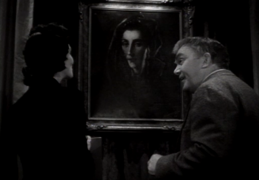 Mona Maris and Thomas Mitchell, the standout performers of the film, share a scene. (Screen capture by Lindsey for TMP)