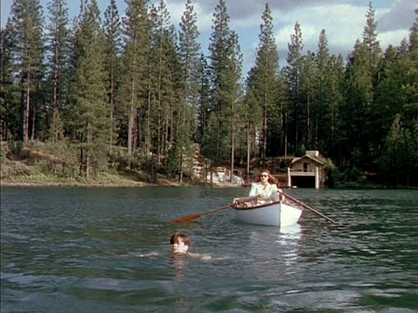 Gene Tierney rows, rows, rows her boat menacingly through the lake in Leave Her to Heaven (Image via Hooked on Houses)