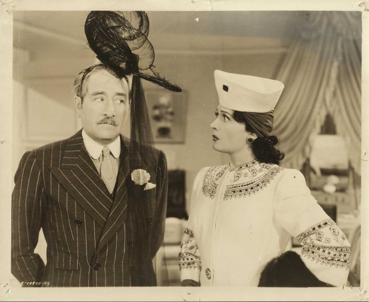 Even Adolphe Menjou gets in on the hat action in this kooky film! (Image via Opera Rex)