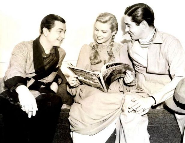 Robert Young on set with co-star Annabella and her off-screen husband, Tyrone Power. (Image via Jack Samuels on Flickr)
