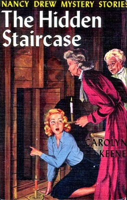 The cover of the 1959 edition of the book shows Nancy's discovery of a hidden passageway, accompanied by Rosemary and Flora. (Image via nancydrewsleuth.com)