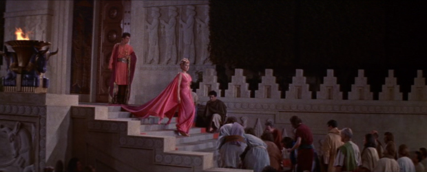 Samarra's kneeling admirers greet her at the temple. (Screen capture by Lindsey for TMP)