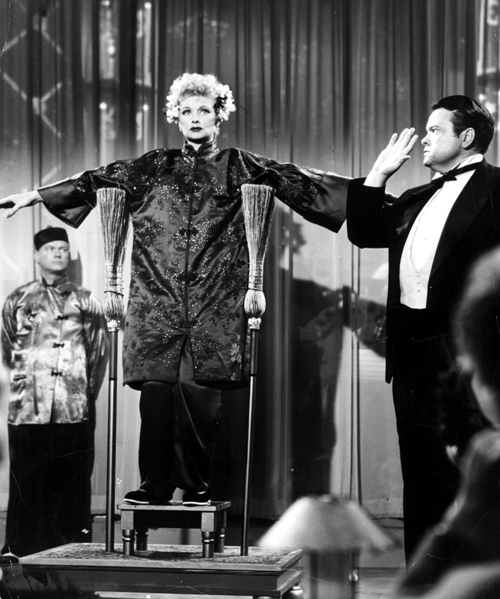 Lucy takes the stage with Orson Welles (Image via Pinterest)
