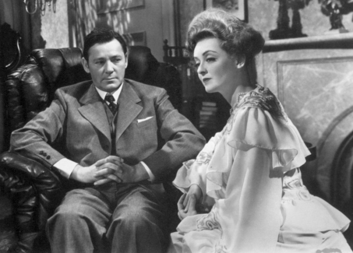 Davis and on-screen husband Herbert Marshall (Image via Taste of Cinema)