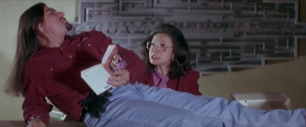 """""""Patience! It's reading time."""" Jonathan Joss is hilarious in the role of ___. (Screen capture by Lindsey for TMP)"""