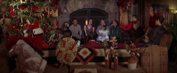 Resort guests and staff celebrate with a holiday sing-along. (Screen capture by Lindsey for TMP)